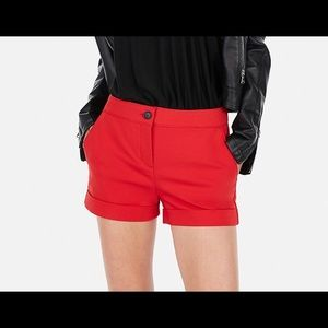 Express red mid rise cuffed cotton shortie shorts.